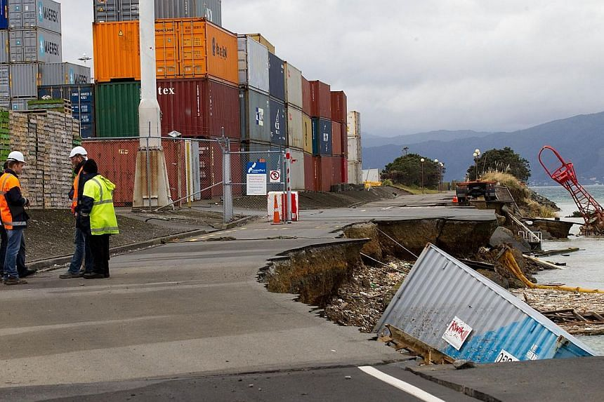 An empty shipping container sits in the harbour where the land fell into the sea at the Port Wellington Container terminal caused by Sunday earthquake on July 22, 2013. -- PHOTO: AFP