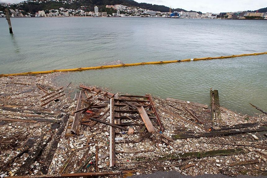 An oil boom is used to hold in debris from where the land fell into the sea at the Port Wellington Container terminal caused by Sunday's earthquake on July 22, 2013.  -- PHOTO: AFP