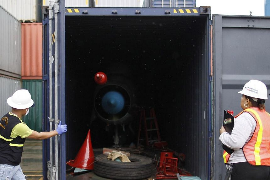 Panamaian forensic workers close a container holding a MiG-21 fighter jet seized from the North Korean-flagged ship Chong Chon Gang, during investigations at the Manzanillo Container Terminal in Colon city on July 21, 2013. Panamanian investigators u