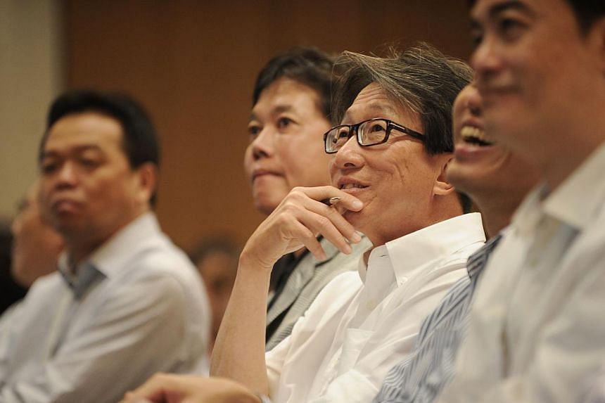 Mr Lim Swee Say (centre), Minister for Prime Minister's office, is pictured with Dr George Quek(second from left), group chairman of BreadTalk Group, during a presentation at the Service Excellence Learning Journey To BreadTalk Group Limited, o