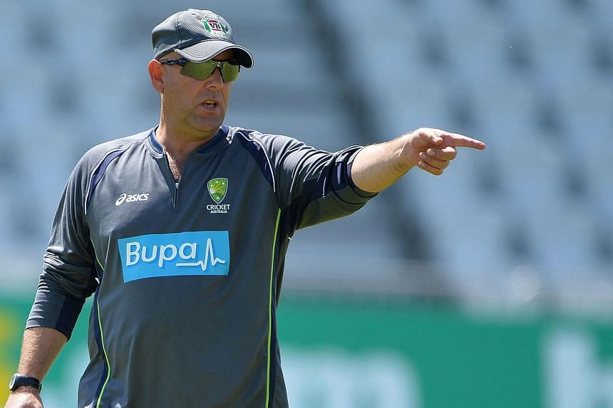 Australia coach Darren Lehmann (above) has warned his under-achieving stars that no-one is safe from the axe ahead of the must-win third Ashes Test. -- FILE PHOTO: AFP
