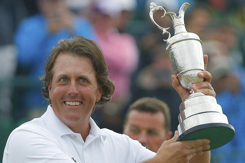 Phil Mickelson of the US holds the Claret Jug after winning the British Open golf championship at Muirfield in Scotland, July 21, 2013. -- PHOTO: REUTERS