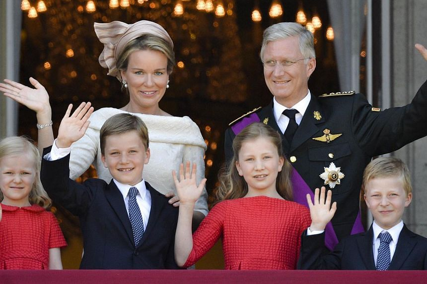 King Philippe of Belgium, his wife Queen Mathilde and children (from left) Princess Eleonore, Prince Gabriel, Princess Elisabeth and Prince Emmanuel, wave to the crowds from the balcony of the Royal Palace in Brussels on July 21, 2013. A list of chil