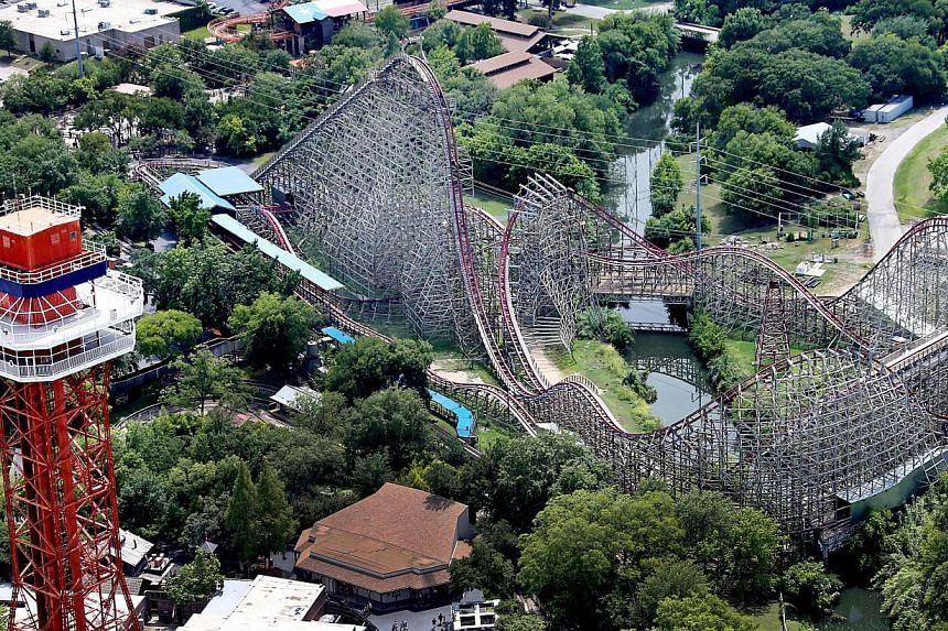 This aerial photo shows the Texas Giant roller coaster at Six Flags Over Texas where a woman fell to her death, Saturday, July 20, 2013, in Arlington, Texas. A woman who plunged from a roller coaster at the Six Flags Over Texas amusement park di