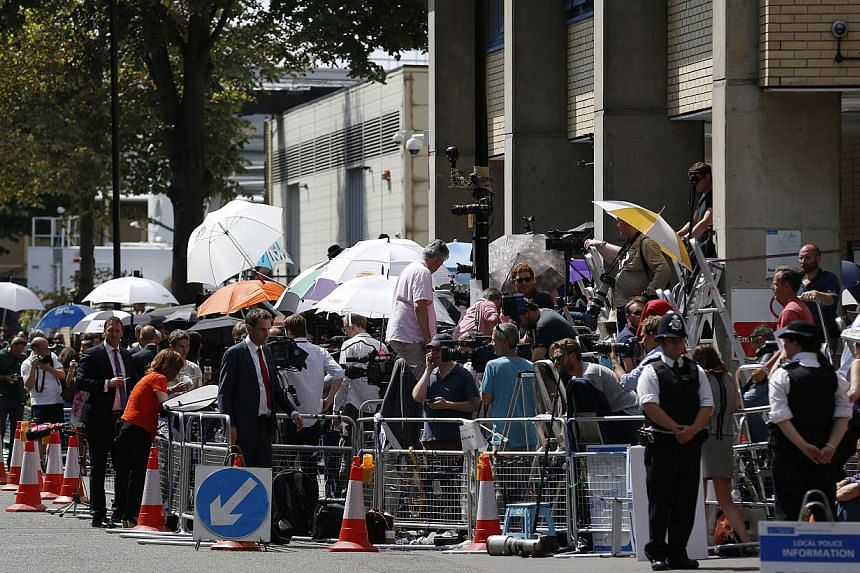 Members of media gather across from St Mary's Hospital Lindo Wing in London, on Monday, July 22, 2013.-- PHOTO: AP