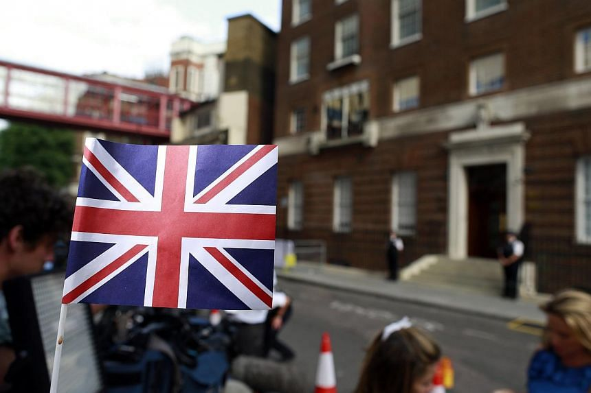 A Union Flag flies outside the Lindo Wing of St Mary's Hospital, where Catherine, Duchess of Cambridge has been admitted to give birth, in London on July 22, 2013.-- PHOTO: REUTERS