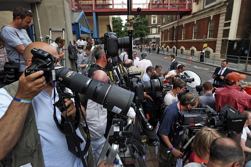 Members of the media wait across St. Mary's Hospital exclusive Lindo Wing in London, on Monday, July 22, 2013. -- PHOTO: AP