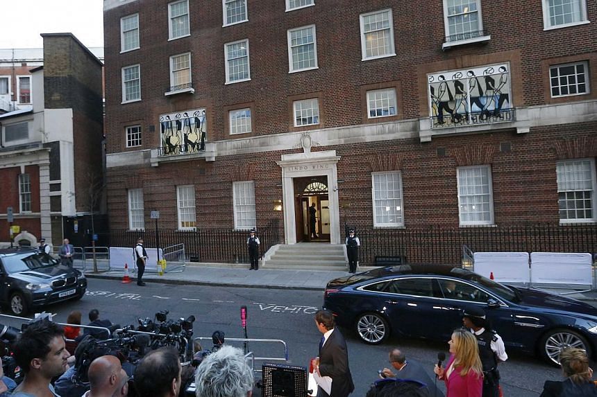 A police motorcade carrying the official birth notice leaves the Lindo Wing of St Mary's Hospital after Catherine, Duchess of Cambridge gave birth to a boy in central London on July 22, 2013. The world was awaiting the first glimpse of Britain's new