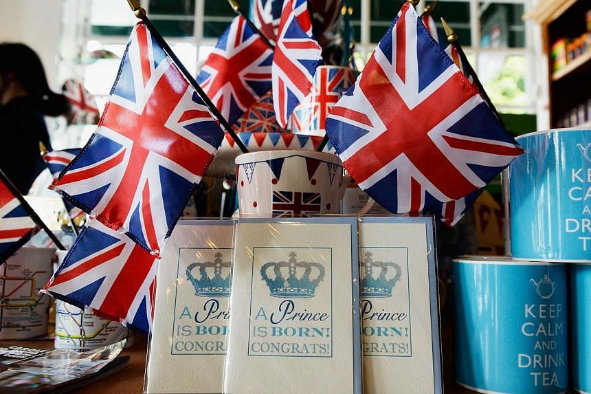 A baby announcement card and flags adorn the gift shop of Ye Olde King's Head English pub to celebrate the announcement of the birth of Catherine, Duchess of Cambridge, and her husband Prince William's first child, on July 22, 2013, in Santa Monica,
