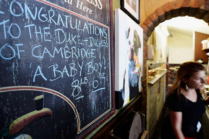 A blackboard inside the Ye Olde King's Head English pub celebrates the announcement of the birth of Catherine, Duchess of Cambridge, and her husband Prince William's first child, on July 22, 2013, in Santa Monica, California. -- PHOTO: AFP