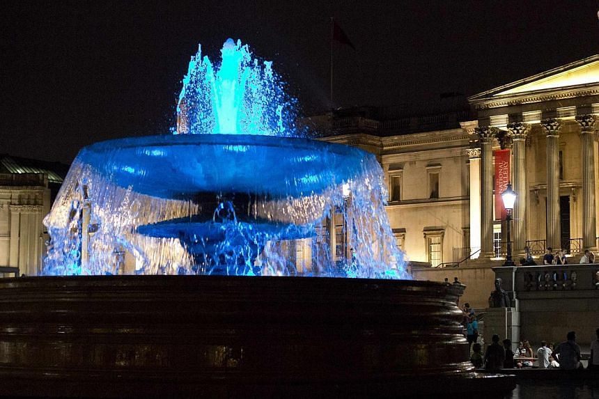 The fountains at Trafalgar Square are seen lit blue to signify the birth of a baby boy to Britain's Prince William and Catherine, Duchess of Cambridge, in London on July 22, 2013. Prince William's wife Kate Middleton gave birth to a baby boy on Monda
