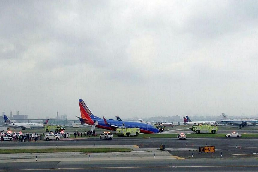 This photo provided by Bobby Abtahi, shows what officials say was a plane where the nose gear collapsed during landing at New York's LaGuardia Airport on Monday, July 22, 2013. Several people were injured when a Southwest Airlines flight with 150 p