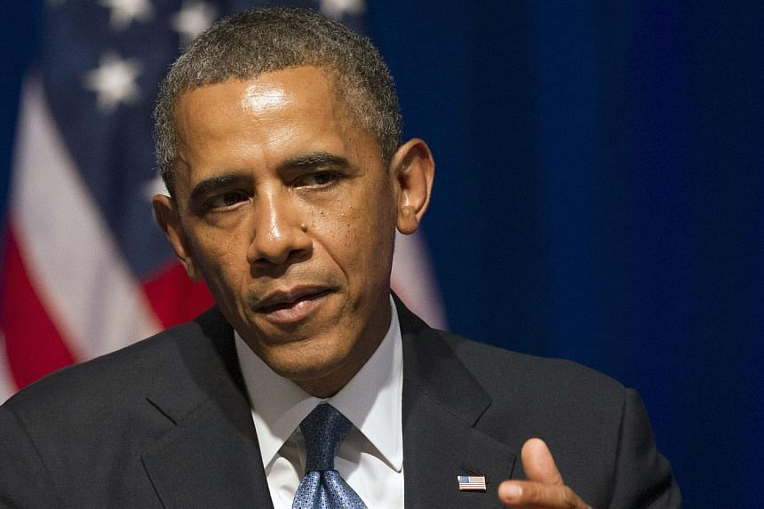 """President Barack Obama addresses an Organizing for Action (OFA) summit in Washington, on Monday, July 22, 2013. Mr Obama has pledged to unveil """"bold"""" ideas to help America's struggling middle class as part of a fresh offensive to boost the economy. -"""