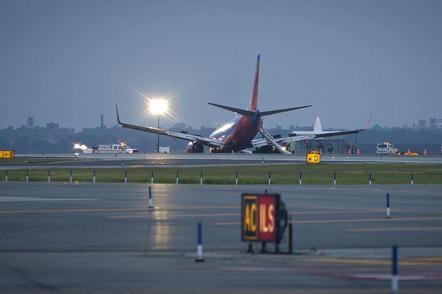 A Southwest Airlines Boeing 737 sits on the tarmac at LaGuardia airport after it made an emergency landing in New York on July 22, 2013. Several people were injured when the plane with 150 people on board, landed without its nose gear, officials said