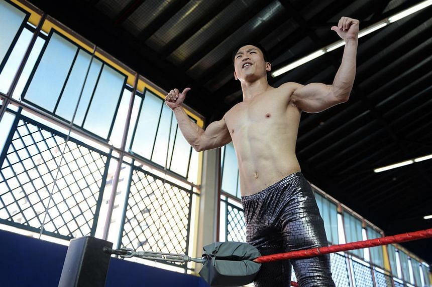 Mr Andruew Tang, a pro-wrestler who believes that Singaporeans can do big things. -- ST PHOTO: EDWARD TEO