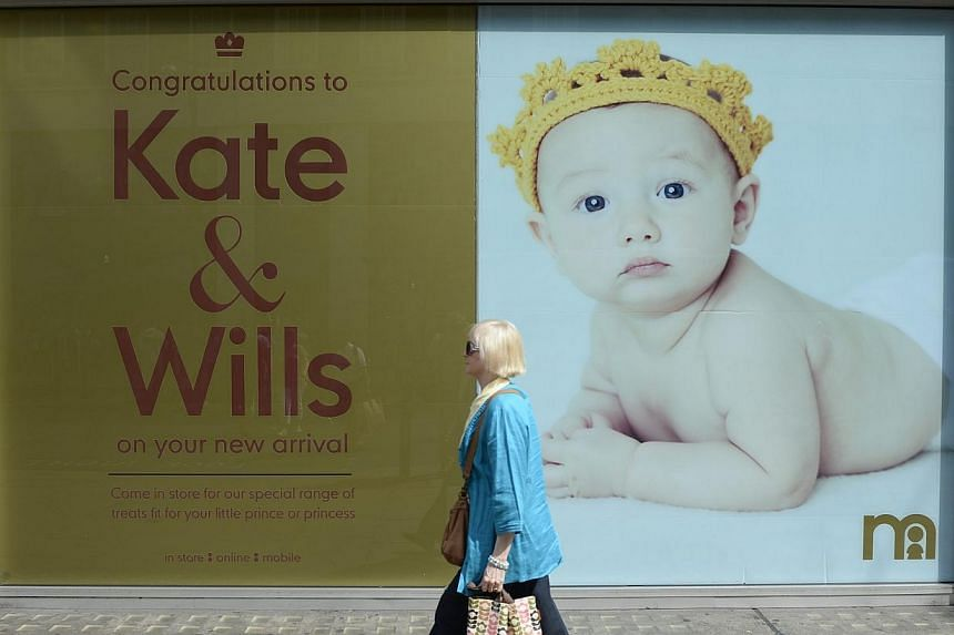 A Mothercare store displays a poster congratulating Britain's Prince William and his wife, Catherine, Duchess of Cambridge on the birth of their baby boy, on Oxford Street in central London on Tuesday, July 23, 2013. Prince William and his wife Kate