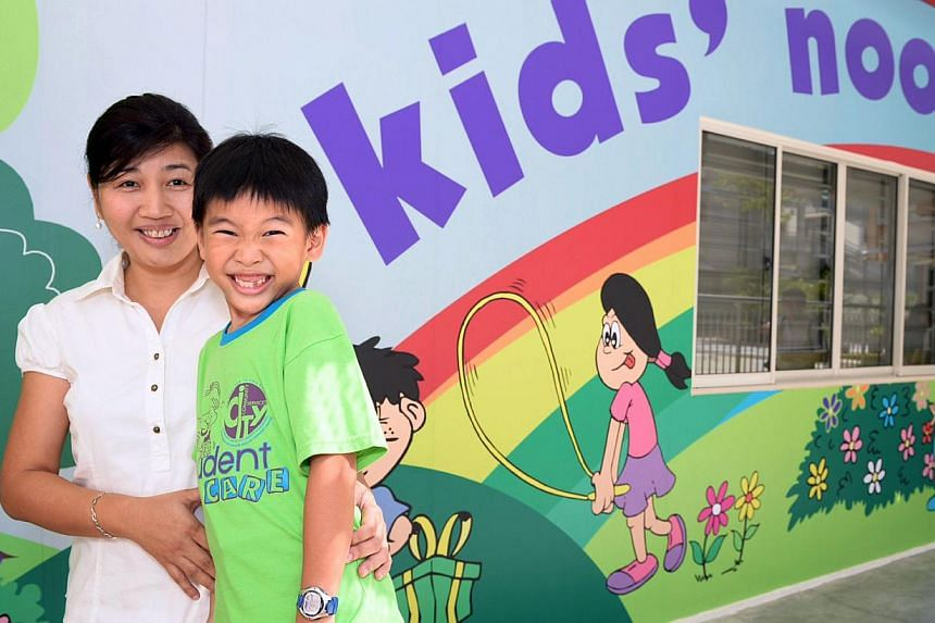 Mrs Rachael Teng with her seven-year-old son Samuel, who goes to the Kids' Nook student care centre in Opera Estate Primary. She says it is better for him to be there than under the care of a domestic helper. -- ST PHOTO: DESMOND WEE