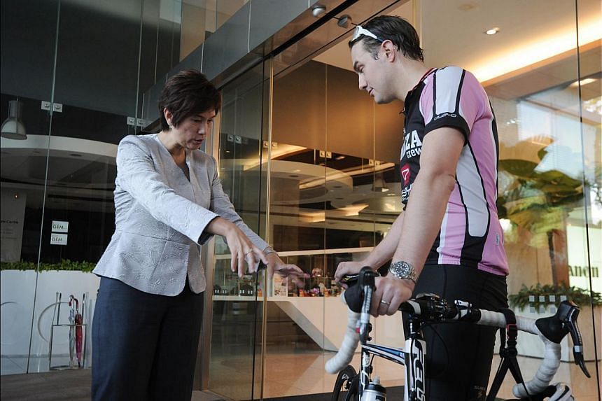 Minister of State for Transport Josephine Teo talking to Mr William Berney, 33, who works at BP Shipping as a charterer, after his morning cycle to work yesterday. She said feedback from LTA's poll was ''disturbing''. It found that not many workers