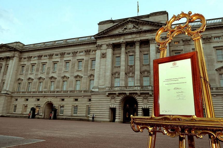 An easel stands in the forecourt of Buckingham Palace in London on July 22, 2013, to announce the birth of a baby boy, at 4.24pm to Prince William and Catherine, Duchess of Cambridge, at St Mary's Hospital. Britain's Prince William expressed his joy