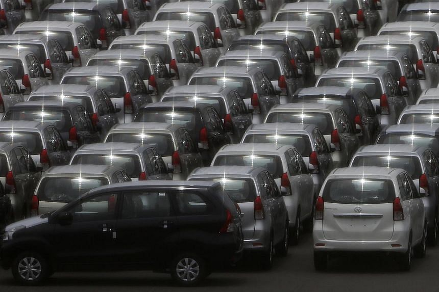 Cars are parked to prepare for export at a port in Yokohama, south of Tokyo, on June 28, 2013. Japan's export growth unexpectedly eased in June from a year earlier in a worrying sign that China's slowing economy is hurting overseas demand and could p