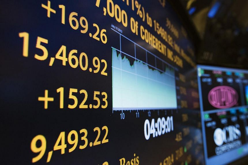 The day's final numbers are shown on an information board above the floor of the New York Stock Exchange shortly before the closing of the market in New York, on July 11, 2013. The Dow industrials and the S&P 500 kept close to record intraday hig