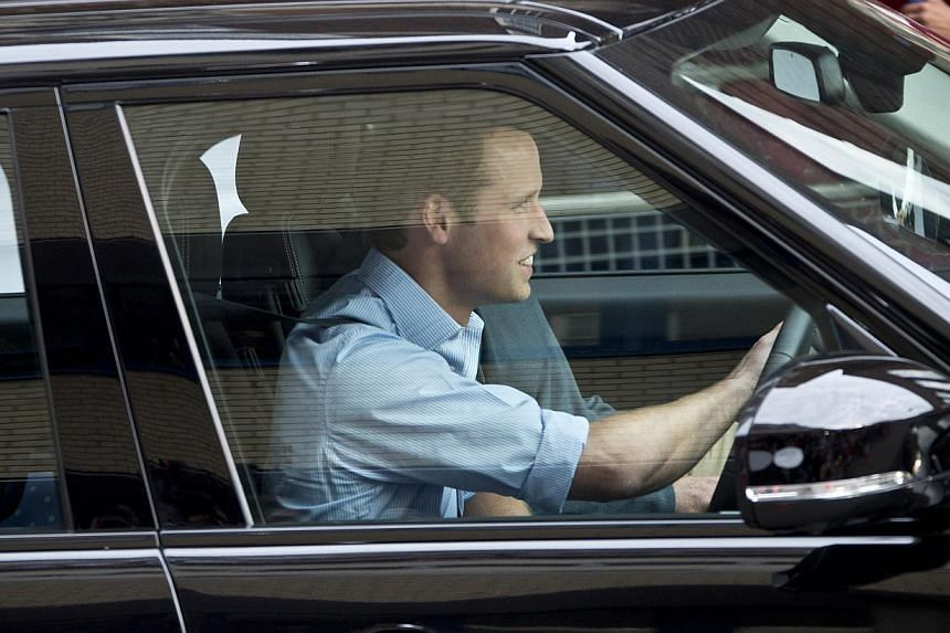 Britain's Prince William drives away his wife Kate, Duchess of Cambridge, and their son, the Prince of Cambridge, on July 23, 2013, as they leave St Mary's Hospital exclusive Lindo Wing in London. The Duchess gave birth on July 22. -- PHOTO: AP