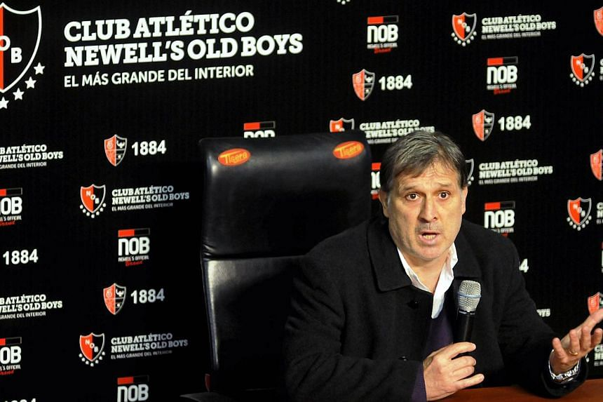 Former Paraguay coach Gerardo Martino speaks during a news conference at the Newell's Old Boys stadium in Rosario on July 23, 2013. Martino believes a recommendation from fellow Argentine Lionel Messi was behind his surprise appointment as Barcelona
