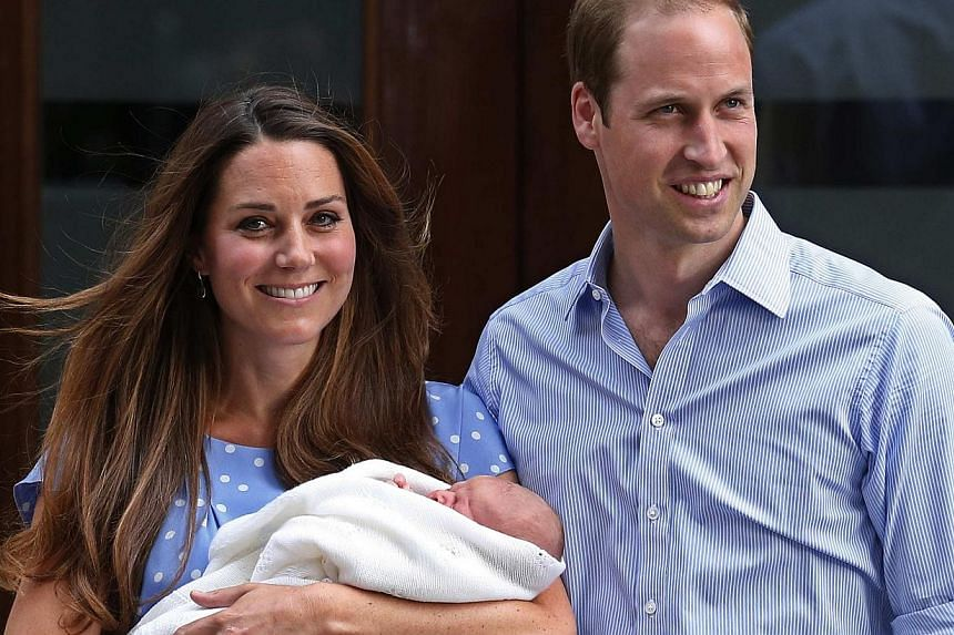 Britain's Prince William and his wife Catherine, Duchess of Cambridge, appear with their baby son outside the Lindo Wing of St Mary's Hospital in central London on July 23, 2013. -- PHOTO: REUTERS