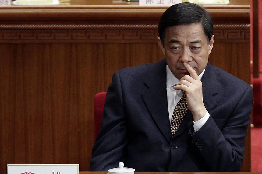 China's Chongqing Municipality Communist Party Secretary Bo Xilai pauses during the opening ceremony of the National People's Congress (NPC) at the Great Hall of the People in Beijing on March 5, 2012. The trial of Mr Bo, a disgraced Chinese politici