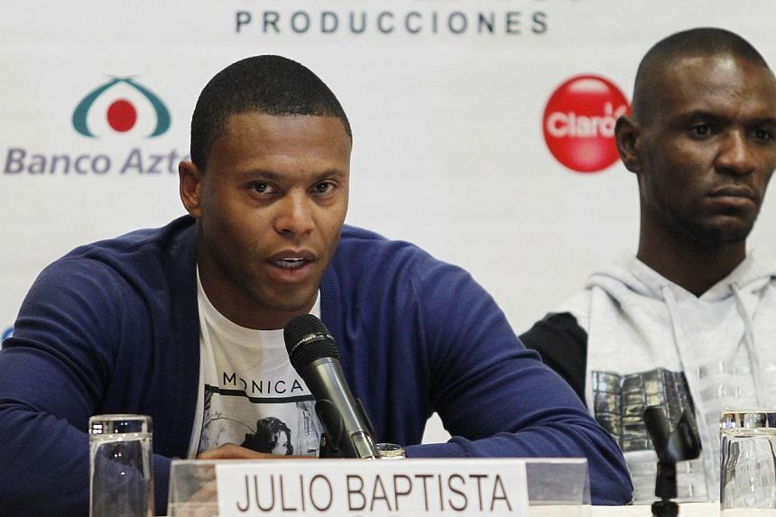 Brazil's soccer player Julio Baptista (left) speaks next to France's Eric Abidal during a news conference before an exhibition game on Tuesday called the Giants Duel: Messi and Friends vs The Rest of The World, in Lima on July 1, 2013. Baptista has a