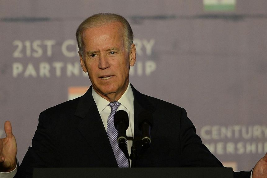 US Vice President Joe Biden addresses a gathering of Indian businessmen at the Bombay Stock Exchange (BSE) in Mumbai on Wednesday, July 24, 2013. Mr Biden urged India on Wednesday to improve investment conditions and remove obstacles faced by America