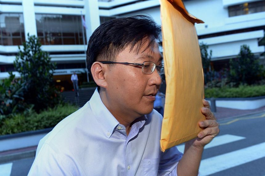 Edwin Yeo Seow Hiong (above), who is facing a string of fraud charges in court, has been released on bail after he managed to raise the $500,000 bail bond set by the court earlier. -- ST PHOTO: LIM SIN THAI