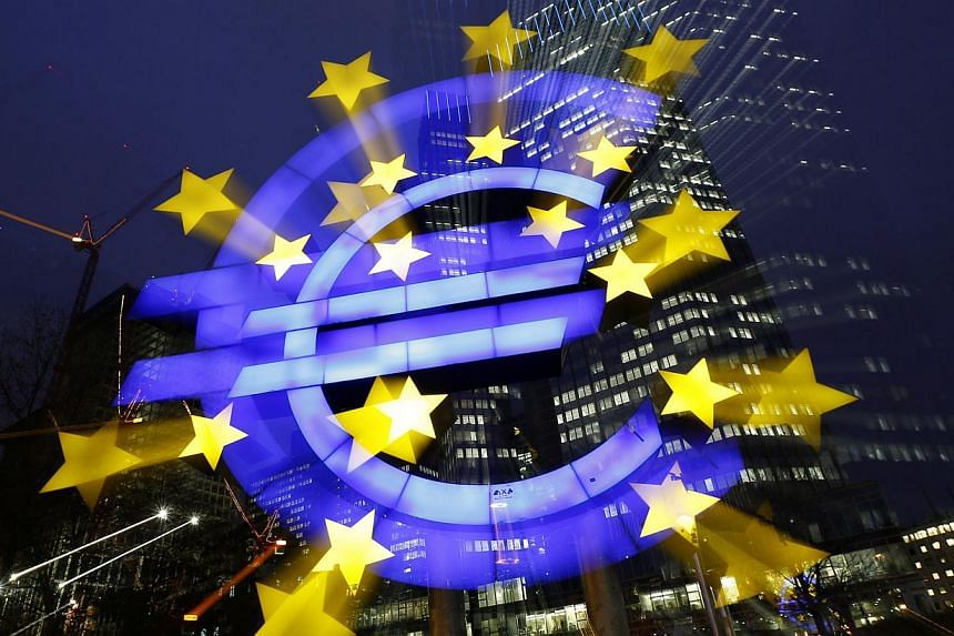 An illuminated euro sign is seen in front of the headquarters of the European Central Bank (ECB) in the late evening in Frankfurt on Tuesday, Jan 8, 2013. In its latest quarterly Bank Lending Survey, the ECB said on Wednesday, July 24, 2013, that few