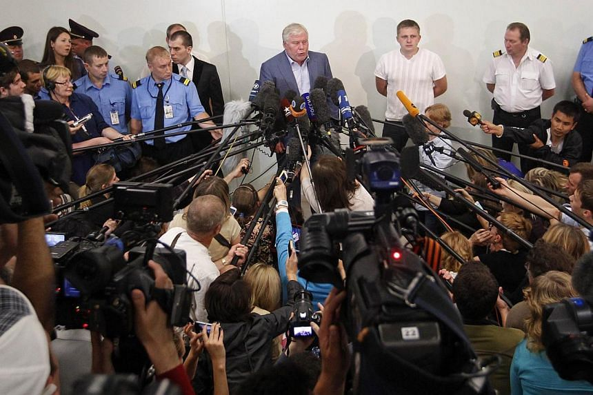 Mr Anatoly Kucherena (centre), the Russian lawyer assisting former US spy agency contractor Edward Snowden, speaks to the media at Sheremetyevo airport in Moscow on Wednesday, July 24, 2013. Snowden has no immediate plans to leave Russia, Mr Kuc