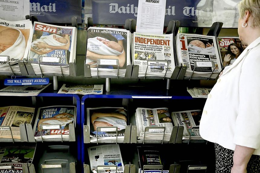 British newspapers showing coverage of the birth of the new royal baby boy are displayed for sale in London on Wednesday, July 24, 2013. The British monarchy's formidable media machine handled the birth of the royal baby smoothly but huge challenges