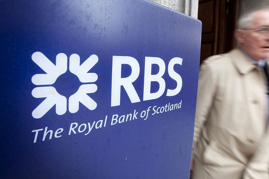 A man walks past a Royal Bank of Scotland (RBS) sign in central London on Feb 24, 2011. Britain's Financial Conduct Authority (FCA) has fined RBS 5.6 million pounds (S$10.9 million) for incorrectly or not reporting at all transactions it made in the