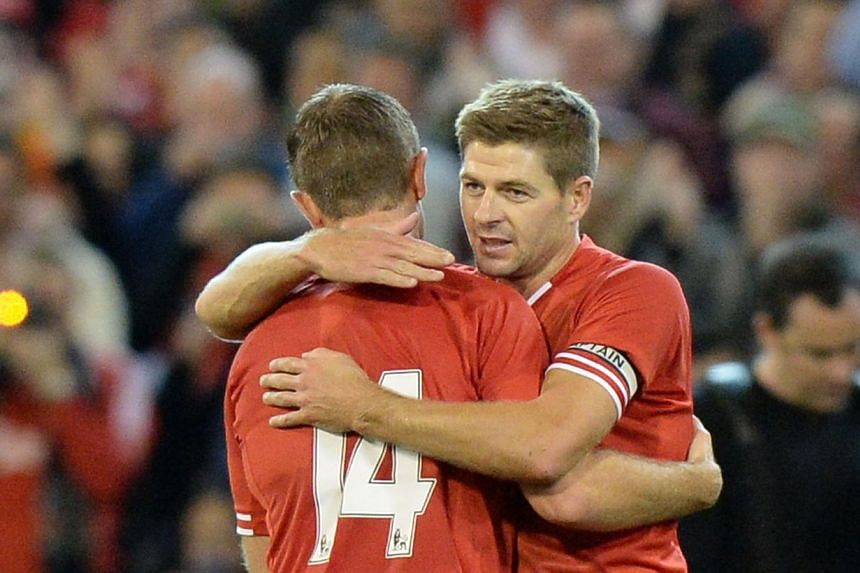 Liverpool captain Steven Gerrard (right) is congratulated by teammate Jordan Henderson after scoring a goal against the Melbourne Victory during their football friendly match at the MCG in Melbourne on Wednesday, July 24, 2013. Gerrard sent the 95,00