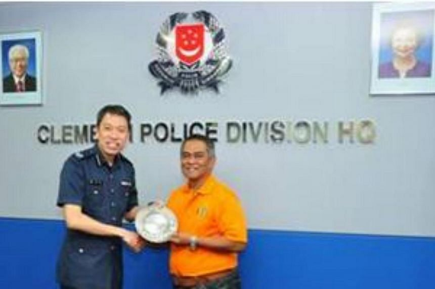 Commander of Clementi Police Division, Deputy Assistant Commissioner of Police (DAC) Melvin Yong (left),presenting the Public Spiritedness Award to MrRohani Julawi (right).Police arrested a 38-year-old man for carrying a knife in We