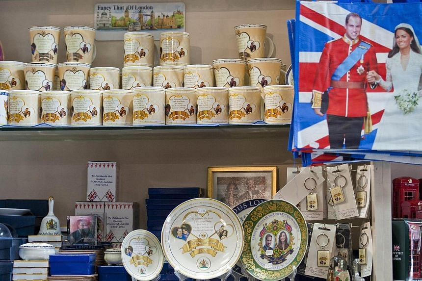 Souvenir gifts celebrating the upcoming birth of the royal baby of Prince William and Kate, Duchess of the Cambridge, are seen on sale in a Souvenir outlet in central London on June 26, 2013. The souvenir mugs (not pictured) are ready to be transport