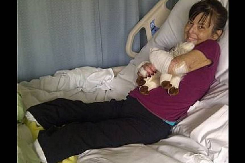 Ms Christine Caron, 49, a single mother of four, lost her left arm and both legs due to a rare infection resulting from a dog bite. -- SCREENGRAB: FUNDRAZR.COM