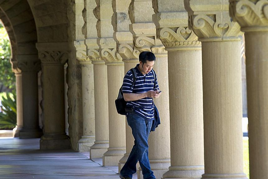 A student heads to class at Stanford University in Palo Alto, California, US, on Wednesday, Jun 8, 2011. California schools bested East Coast universities in Forbes' annual ranking of top United States (US) colleges on Wednesday, with Stanford Univer