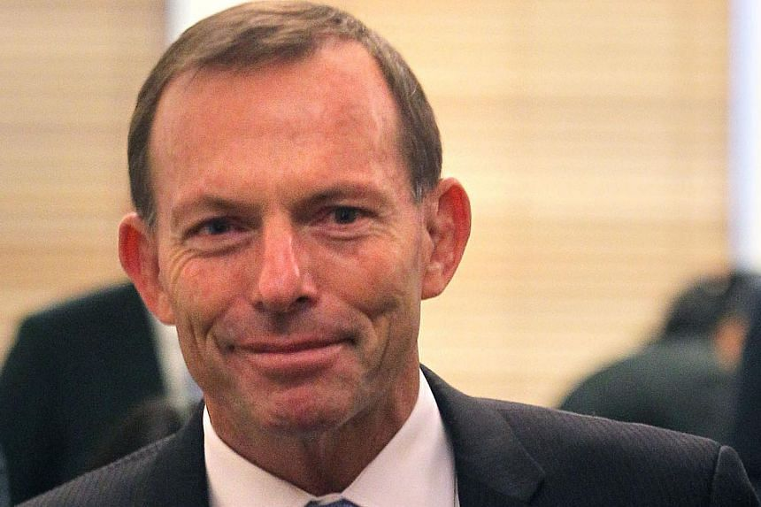 Australian opposition leader Tony Abbott at Parliament House in Canberra on Oct 11, 2012. Australia's conservative opposition unveiled plans for a military-led response to repel boat people. -- ST FILE PHOTO: KEVIN LIM