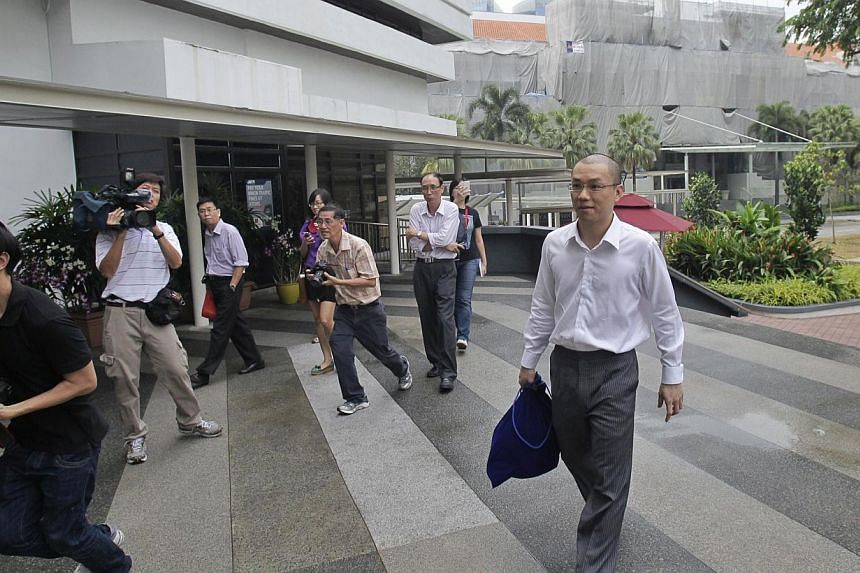 Former law professor Tey Tsun Hang arrives at the Subordinate Courts on June 26, 2013, to begin his five-month jail term for corruption. The appeal hearing for Tey against his conviction and five-month jail sentence has been set for October. -- ST FI