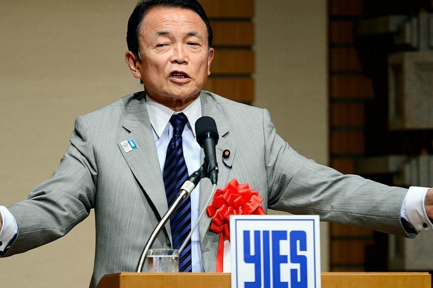 Japan's Finance and Deputy Prime Minister Taro Aso gestures as he delivers a speech in Tokyo on June 28, 2013. -- FILE PHOTO: AFP