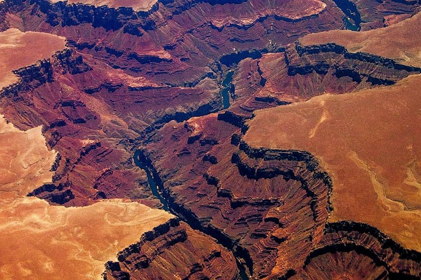 The Grand Canyon in Arizona on July 1, 2013. A lightning bolt struck a group of sightseers at an overlook near the Grand Canyon, killing a couple who were visiting from another country and injuring a boy, authorities said on Wednesday. -- FILE PHOTO: