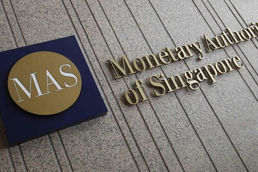 The logo of the Monetary Au thority of Singapore (MAS) is pictured at its building in Singapore in this Feb 21, 2013 photo.MAS had said that 5 to 10 per cent of borrowers here have probably overstretched themselves on their property purchases. -- FIL