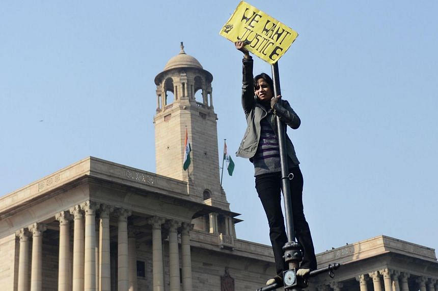 In this photograph taken on December 22, 2012, An Indian demonstrator holds up a sign during a protest in front of the Government Secretariat and Presidential Palace in New Delhi, calling for better safety for women following the rape of a student in