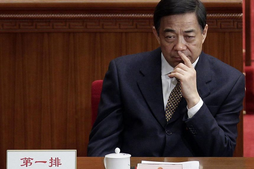 China's Chongqing Municipality Communist Party Secretary Bo Xilai pauses during the opening ceremony of the National People's Congress (NPC) at the Great Hall of the People in Beijing in this March 5, 2012 file photo. China has charged disgraced