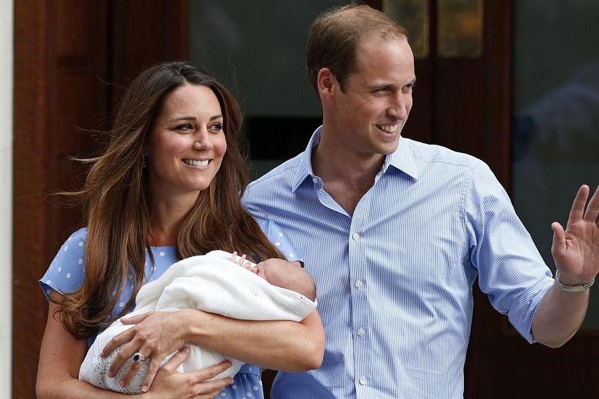 In this Tuesday, July 23, 2013 photo, Britain's Prince William and Kate, Duchess of Cambridge hold the Prince of Cambridge, as they pose for photographers outside St. Mary's Hospital exclusive Lindo Wing in London where the Duchess gave birth on Mond