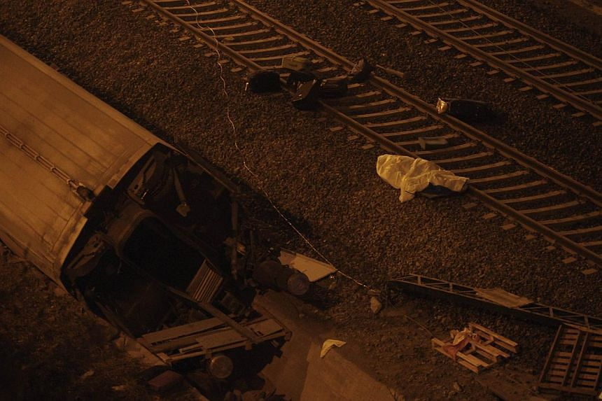 A derailed car at the site of a train accident near the city of Santiago de Compostela on July 24, 2013. At least 20 people died after a train derailed on Wednesday, local Galician television and the Cadena Ser radio station reported. -- PHOTO: